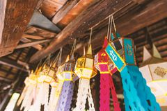 Thai lantern in Yee Peng festival, Thailand. Thai Lanna lantern style hanging on wooden ceiling in the temple, Yee Peng festival in Chiang Mai,Thailand royalty free stock photos