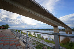 Thai-Lao bridge in evening in Nongkhai Thailand. Steel Railing on blue sky background,Mekong riverside,Nongkhai Thailand in evening,Thai-Lao bridge in evening in Stock Photos