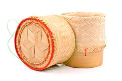 Thai Lao Original Handwoven Bamboo Sticky Rice isolated. Stock Photo
