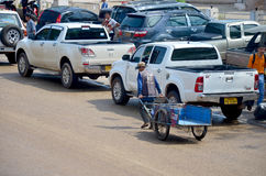 Thai and lao people service use cart for carry goods at Chong Me Royalty Free Stock Photography