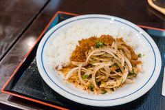 Thai Larb menu fusion on Tonkatsu served with steamed rice on tr. Larb menu fusion on Tonkatsu served with steamed rice on tray. Northeastern style recipe with royalty free stock photos