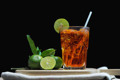 Thai lemon iced tea. On black background Stock Photos