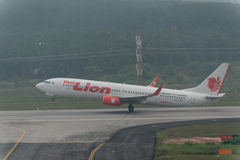 Thai lion air airline take off in haze at krabi airport Stock Images