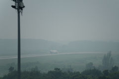 Thai lion air airline taxi in haze at krabi airport Royalty Free Stock Photo