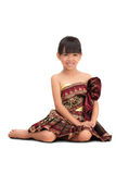 Thai littile girl dressing with traditional style. On white stock photos