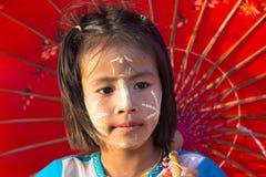 Thai little girl holding umbrella Stock Photography