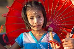 Thai little holding umbrella Royalty Free Stock Images