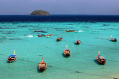 Thai local fishing boats on seaside at Lipe island beach  Stock Photo