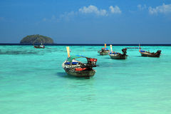 Thai local fishing boats on seaside at Lipe island beach Royalty Free Stock Images