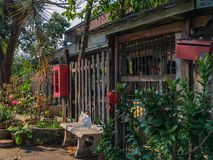 Thai local old wooden entrance gate under the shade and peaceful royalty free stock photos
