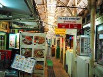 Thai local restaurant in narrow alley of `Tha Phra Chan` pier. BANGKOK, THAILAND - SEPTEMBER 25, 2017: Local street food restaurant in narrow alley of `Tha Phra royalty free stock photos