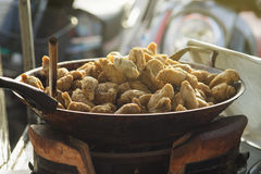 Thai local street food,fried rugby fish ball in a hot pan,light effect added,selective focus.  royalty free stock photo