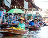 Thai locals sell food and souvenirs at famous Damnoen Saduak floating market, Thailand Royalty Free Stock Photography