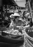 Thai locals sell food and souvenirs at famous Damnoen Saduak floating market, Thailand Royalty Free Stock Image