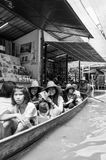 Thai locals sell food and souvenirs at famous Damnoen Saduak floating market, Thailand Royalty Free Stock Images