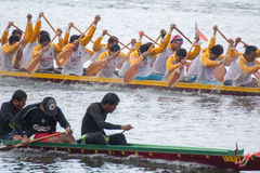 Thai long boat traditional compete Stock Photo