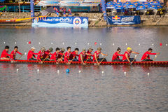Thai long boats compete during King's Cup Native Long Boat Race Stock Photo