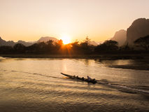 Thai long-tail boat in the Nam Song river. Long-tail boat in the Nam Song river, Vang Vieng, Laos Royalty Free Stock Photos