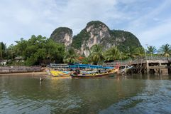 Thai long tail boats at pier Royalty Free Stock Photos