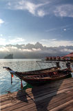 Thai long-tail boats at the wooden pier Royalty Free Stock Photos