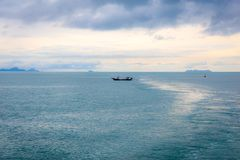 Thai long tail fishing boat fishing in the sea. Thai long tail fishing boat fishing in the sea Royalty Free Stock Photos