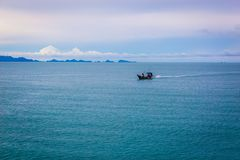 Thai long tail fishing boat fishing in the sea. Thai long tail fishing boat fishing in the sea Stock Photography