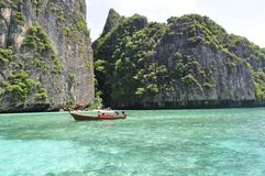 Thai long tale boat in the ocean with tourists Stock Images