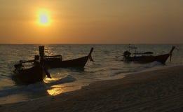 Thai longboats on beach. Thai Longboats on the beach at sunrise Royalty Free Stock Photos
