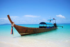 Thai longtail boat, Thailand. A traditional Thai longtail boat on turquoise waters of the Andaman sea, Thailand stock photo