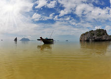 The Thai Longtail boat. Bay on oceanic islands Royalty Free Stock Images
