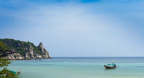 Thai longtail boat. Longtail boats on an idyllic tropical shore Royalty Free Stock Photography