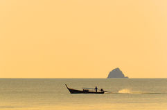 Thai longtail boat at sunset. Traditional longtail boat on the Andaman Sea in Thailand at sunset Stock Photos