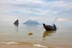Thai Longtal boat moored on a beach Stock Photo