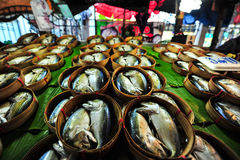 Thai Mackerel fish in bamboo basket on the banana leaf that you. Can see in every market in Thailand. It is a Thai traditional food Stock Images