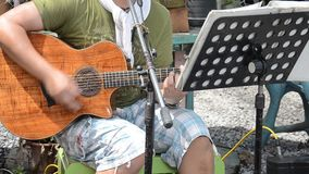 Thai male play acoustic guitar for show traveler. stock video footage