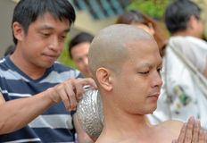An Thai male sit for  ordain ritual with his family Stock Photography