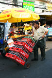 Thai man delivers coke, Bangkok. Stock Photos