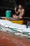 A Thai man keeps enjoying his life  in a flooded street of Bangkok, Thailand, on 30 November 2011.  Stock Image