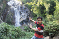 Thai man with Mae Tia Waterfall, Obluang National Park Stock Photo