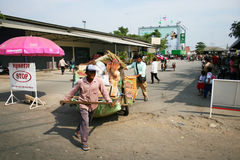 Thai man pulls a cart, Thailand. Royalty Free Stock Images