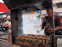 Thai man selling food in the streets of Nakhon Ratchasima Stock Images