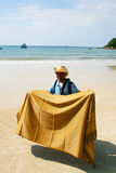 Thai man selling silk, Koh Samet, Thailand. Stock Photo