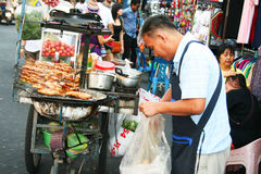 Thai man sells thai food, Bangkok, Thailand. Royalty Free Stock Images