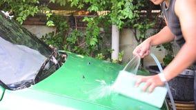 Thai man washing car stock video footage
