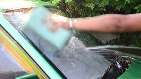 Thai man washing car stock video