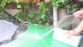 Thai man washing car stock footage