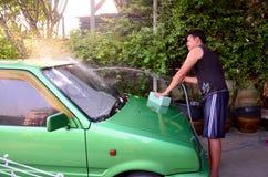 Thai man washing mini car green color Stock Photo