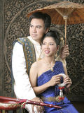 Thai man and woman in silk dress Stock Image