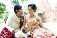 Thai man and woman in silk dress Stock Photo
