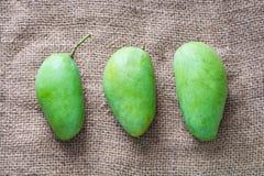 Thai mango, tropical fruit on traditional fabric Royalty Free Stock Photo